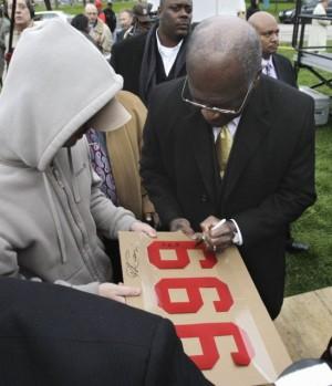 Herman Cain – 999 or 666?