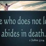 "What does ""passed from death to life"" mean in 1 John 3:14?"